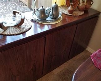 Beautiful buffet goes with oval dining set