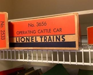 LIONEL TRAIN , MANY PARTS AND MANY PIECES STILL IN ORIGINAL BOXES. TRACKS AND ASSORTED VILLAGE PIECES.  SOLD AS A COMPLETE SYSTEM, NO SEPARATING PIECES.