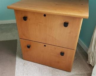Lateral file system, can convert to vertical on one drawer Have keys for both drawers