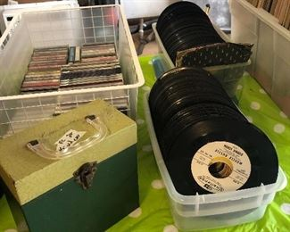 lots of 45 records- cassettes-cd's and vhs- few dvd's too   and 1 vintage 45 case :))