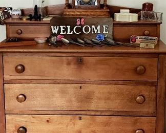 Four drawer maple chest has hanky drawer top, key wind clock etc.
