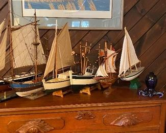 Beautiful antique dresser and model ships and sailboats