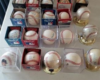 27 signed baseballs including Ted Williams and Joe Dimaggio.