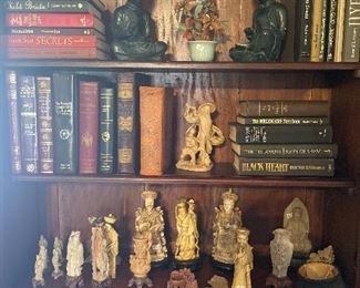 Antique books and Asian figurines