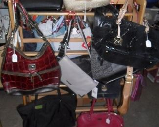 Designer purses by Michael Kors, Kate Spade, Gucci, Coach and more