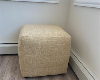 1 of 2 matching smaller pale yellow ottomans