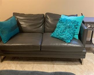Dark gray leather couch w/chrome legs and matching love seat