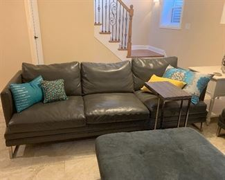 Dark gray leather couch w/chrome legs and matching loveseat