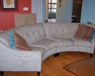 Round Back Sofa, has 2 sections, pillows included.  We have 2 of these sofas!