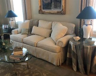 Traditional Classic Sofa. Side tables include covers. Custom rugs throughout.