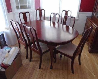 Solid Cherry dinging table and 8 chairs (2 leaves)