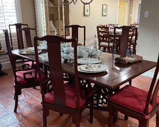 Asian style dining table, mahogany, 20th century. Priced with 8 chairs, upholstered seat cushions.
