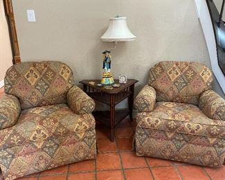 Pair of swivel club chairs.