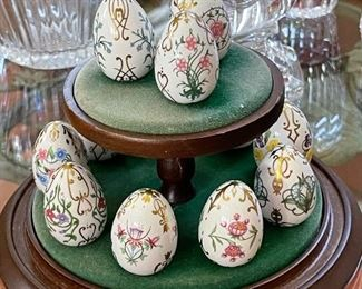 Hand painted porcelain eggs with stand.