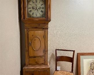Tall case clock. Mid-19th century, mfg by Hunlock. Pine frame with painted metal moon phase face.