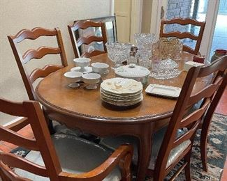 French mahogany oval dining table.  6 cherry ladder back dining chairs. Table & chairs priced separately.