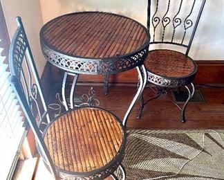 """10.Iron & wicker bistro table 27 ½""""R with 2 chairs (table missing a stretcher) $90 as is"""