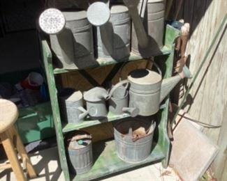 Antique complete galvanized water cans