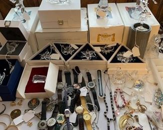 Swarovski crystal, watches, and a small portion of the large collection of costume jewelry
