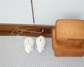 Piggy banks by Tiffany & Co. $125 each. Rattan and wood baskets: Large $35, Small $25