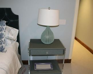 Pair of pale green side tables: wood and lucite. $650 each. Pair of green glass lamps: $250 each