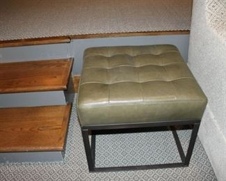 Ogden tufted leather ottoman with metal base $600 each. There are 2 left
