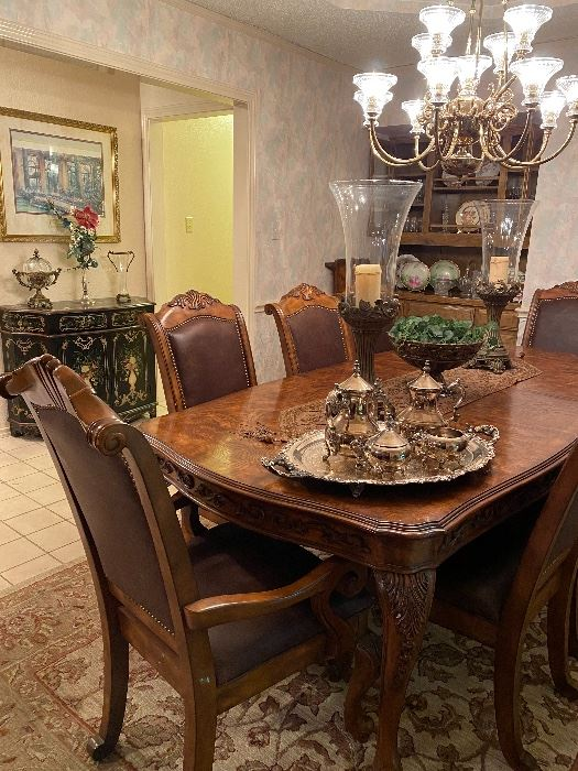 Gorgeous & oh so elegant. This table seats 8 and there is an additional leaf that can be used to expand the table.  Beautiful decor- silverplate tea set, serving tray, large candleholders big enough to not get lost on this table.