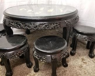 Vintage Chinese Black Lacquer Tea Table and Stools.  Handpainted Mother of pearl scene under glass top.