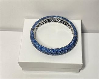 Sapphire and 18k white gold bracelet. Stamped 18k and 750. The bracelet is around three inches at it widest. The inside of the bracelet is around two and three eights inches at its widest.  price 4000 dollars.