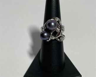 14k White gold ring. Size five and three quarters. Diamonds and real pearls. price 500 dollars.