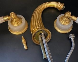 Basin faucet set by Sherle Wagner International.  Burnished gold plated finish over solid brass construction. https://capitolsalesservices.hibid.com