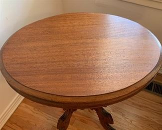 """#2Antique oval side table from late 1800s with glass top on casters 29""""x22""""x28"""" $175.00"""