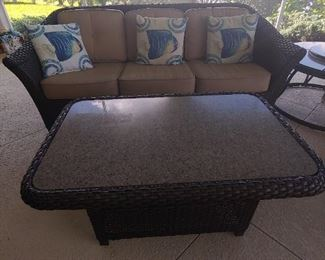 Patio Couch & Coffee Table.  (There is an additional Top for the coffee table-same- color) Vinyl Wicker, Brown with taupe cushions