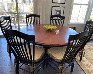 """Lot 5500 $1,200.00.  60"""" Round Nichols & Stone Dining Table With One 18"""" Leaf, 6 Chairs & Cute Cushions, Chairs are black in color,  as is the base of the table, the tabletop is a warm cherry.  The fabulous table could be great for the kitchen eating area or dining room.  Normal usage wear on the tabletop.  This one won't last!"""