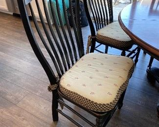 """Lot 5500 $1,200.00.  60"""" Round Nichols & Stone Dining Table With One 18"""" Leaf, 6 Chairs & Cute Cushions, Chairs are black in color,  as is the base of the table, the tabletop is a warm cherry.  This fabulous table could be great for the kitchen eating area or dining room.  Normal usage wear on the tabletop.  This one won't last!"""
