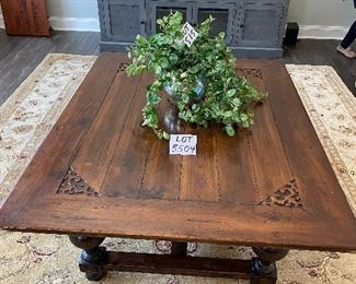 """Lot 5504. $200.00. Massive Hardwood Coffee Table, with Turned Legs, Carving at the corners, plenty of style, intentionally distressed.  Fits in with a farmhouse style.  43""""w x 55""""l x20""""h. Heavy. Great table for a home with kids. Other items in this picture are available in upcoming lots."""
