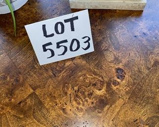 """Lot 5503. $175.00. Cute Round Lamp Table with Burlwood parquetry top, Metal legs on a triangular base.  Tabletop is 28"""" in diameter, height 29"""". (Lamp and plant are grouped in Lot 5508)"""