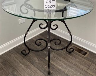 """Lot 5507  $175.00 Beveled Glass Top Side/Foyer Table with Wrought Iron Base. 36""""round x 31""""h Lamp is available in a later lot."""