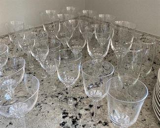 Lot 5523.  $80.00   Vintage crystal set - 29 glasses:  12 coupe; 7 wine; 8 goblets; & 2 flutes.  Nice crystal - Time to stock your bar!