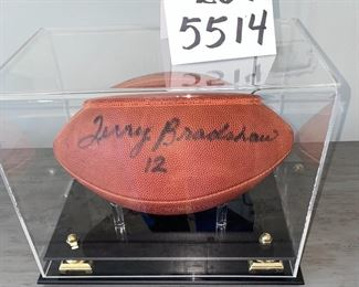 """Lot 5514. $225.00. Terry Bradshaw Signed Football, in Sharp Acrylic Footed Case, measures 12.5"""" long, 8"""" wide x 9.5"""" tall.  No COA, but nice clear signature!"""