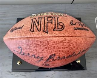 """Lot 5514. $225.00. Terry Bradshaw Signed Football, in Sharp Acrylic Footed Case, measures 12.5"""" long, 8"""" wide x 9.5"""" tall.  No COA, but nice clear signature, Perfect for your Man Cave!"""