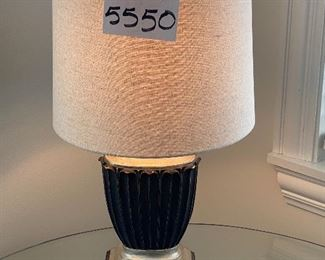 """Lot 5550.  $40.00.  Cute table lamp with fabric shade; the lamp is black with platinum accents.  23"""" t on a 7"""" x 5"""" base; the lampshade is 11"""" in diameter."""