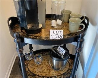 Lot 5518. $125.00  Really Handy Two-Tray-Tiered Butler Table, shown here as a Coffee Station - both 2 handled trays are removable, hand-painted, and very functional. Please note that Lot 5520 is the Keurig Machine, a glass canister (perfect for storing K-Cups or beans), and 4 Pottery Barn Mugs, that lot is $65.00.