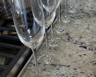 Lot 5524.  $18.00.  6 sleek champagne flutes (1 has a chip on the base).