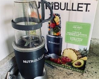 Lot 5540.  $26.00   Nutribullet set with box, includes; power base, short cup with a handled ring, tall cup, extractor blade, 1 lip ring, and a care booklet.