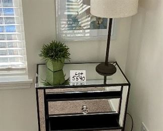Lot 5590.  $235.00.  Matched pair of mirrored 3 drawer side chests.  Chrome hardware includes an artificial plant as shown on top (lamp available next).