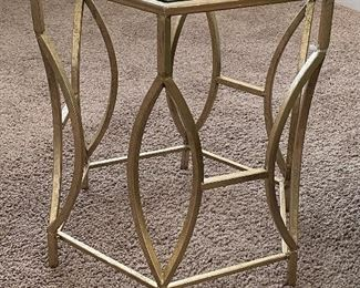 Lot 5586.   $95.00    Goldtone metal tubular base with hexagon-shaped glass side table.  Only one available.