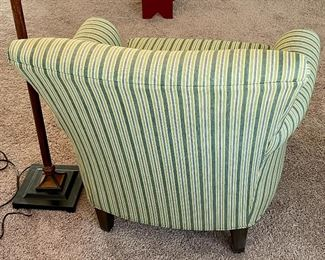 """Lot 5587.   $275.00. Crate & Barrel accent chair in green and gray striped pattern.  Firm and comfortable. 33"""" H x 33"""" W x 31"""" D"""