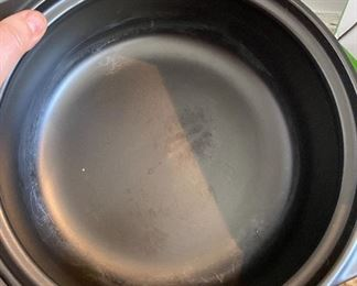"""Lot 5554.  $58.00   Pampered chef 'Rockcrok' 4Qt Dutch Oven. Retails for $140.00. """"The Rockcrok® Dutch Oven is the perfect size for cooking for a crowd, and because it's made from durable clay material, you can use it for any cooking method. It's safe for the stovetop, broiler, oven, microwave, and grill. Plus, unlike other types of ceramic cookware, you can use Rockcroks right away without needing to preseason."""""""