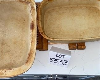 Lot 5553.   $60.00   Pampered Chef Family Heritage stone baker with cover and sits on an expandable wood-handled trivet.   Note:  do not be alarmed by the discolorations on this piece - every one of them gets like this upon using only once!